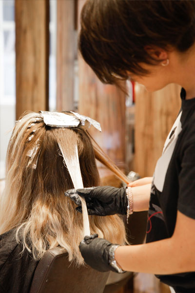 Marta in action, working on a balayage