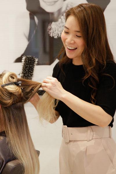 Yoko Shimada blowdrying a client at Hiro Mioshi