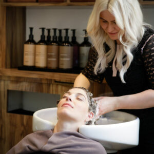 A client relaxing at the backwash of the hair salon Hiro Miyoshi Curzon Street