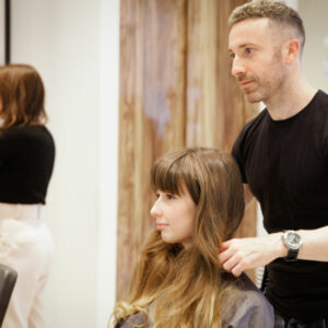 Hairdresser Carlos finishing a client's cut and blow dry