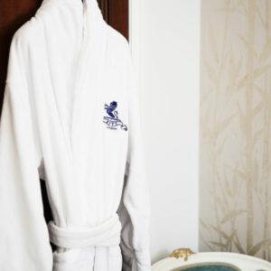 Luxurious bathrobe hanging at Hiro Miyoshi at The Ritz