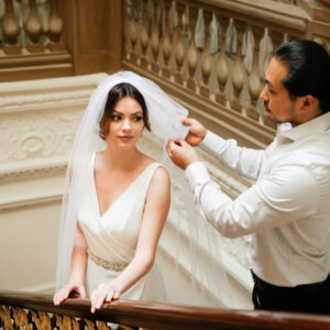 Bride at The Ritz London staircase, being prepared by world renowned hairstylist, Hiro Miyoshi