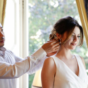 Renowned hairdresser, Hiro Miyoshi, performing bridal hair for a young bride